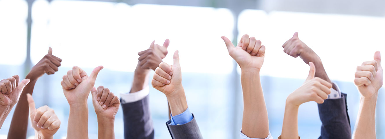 business people's hands, giving thumbs up in the air
